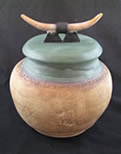 clay pot with horns on lid